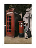Girl Places an Envelope in a Postbox Next to a Telephone Booth Photographic Print by Clifton R. Adams