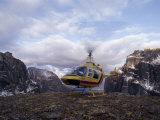 Helicopter Lands on a Mountain in the Cirque of the Unclimbables Photographic Print by Gordon Wiltsie