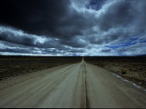 Storm Clouds over a Dirt Road Photographic Print by David Edwards