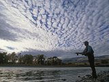 Fly Fisherman Casts for Trout in the Yellowstone River Photographic Print by Gordon Wiltsie
