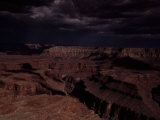Clouds Sweep the Sky Above the Grand Canyon, Casting Deep Shadows Photographic Print by Michael Nichols