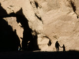 Mother and Son Hike Up Dry Wash at Natural Bridge Scenic Site Photographic Print by Gordon Wiltsie