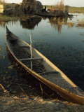 Empty Rowboat in the Water across from a Rubeh Island Village Photographic Print by Lynn Abercrombie