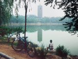 Student Relaxes on Campus of Peking University in Beijing, China Photographic Print by O. Louis Mazzatenta