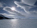 Sun and Lenticular Clouds over a Bare Ice Glacier by Patriot Hills Photographic Print by Gordon Wiltsie