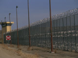Guard Towers and Razor Wire Encircle the State Prison in Deer Lodge Photographic Print by Gordon Wiltsie