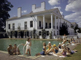 People Sunbathe Beside a Swimming Pool at Charlotte Country Club Photographic Print by Joseph Baylor Roberts