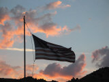 American Flag Rises at Sunset Above a Cemetery, Nevada Photographic Print by Charles Kogod