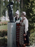 Two Young Women Stand Outside, Admiring a Statue Photographic Print by Gustav Heurlin