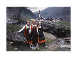Three Women Pose on a Boulder Outside the Town of Gressoney Photographic Print by Hans Hildenbrand