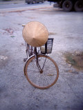 Bicycle with a Conical Bamboo Hat in Vietnam Photographic Print by  xPacifica