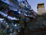 Buddhist Prayer Flags Surround Yumbu Lakang, Tibet's Oldest Building Photographic Print by Gordon Wiltsie