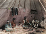American Indian Family Relaxes Inside their Tipi Photographic Print by Edwin L. Wisherd