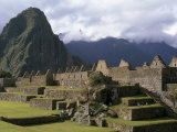 Reconstructed Stone Buildings and Staircases in Machu Picchu Photographic Print by Gordon Wiltsie