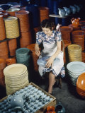 Post Kiln-Firing, Pots are Inspected for Rough Spots and Cleaned Up Photographic Print by Volkmar K. Wentzel