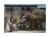 Locals Gather under Flowered Gateways Outside Rome Photographic Print by Hans Hildenbrand