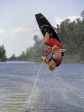 Young Wakeboarder Tries Tries a Flip on Lake of the Woods, Ontario Photographic Print by Gordon Wiltsie