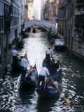 Gondoliers Steer their Gondolas with Tourists Down a Canal in Venice Photographic Print by O. Louis Mazzatenta