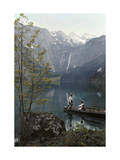 Man and Woman Row in a Boat on the Obersee Lake Near the Mountains Photographic Print by Hans Hildenbrand