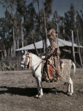 Minister of War Rides a Mule While Modeling His Lion Headdress Photographic Print by W. Robert Moore