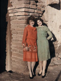 Two Mexican Girls Pose Against a Brick Wall in Nogales Photographic Print by Clifton R. Adams