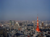 Tokyo City Skyline, with the Famous Tokyo Tower Illuminated Photographic Print by  xPacifica