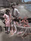 Puerto Rican Girl and Man Sit on the Bow of a Boat with their Catch Photographic Print by Charles Martin