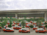 Taxis Parked in a Parking Lot Outside of the Hong Kong Airport Waiting for Passengers Photographic Print by  xPacifica
