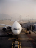Jumbo Airplane Parked on the Tarmac at the Airport in Hong Kong Photographic Print by  xPacifica