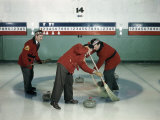 Red-Blazered Men Sweep Brooms on an Ice Rink in a Game of Curling Photographic Print by Jack Fletcher