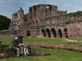 Couple Sits Outside of the Remains of Furness Abbey Photographic Print by Clifton R. Adams