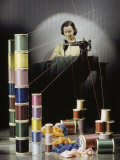 Woman Sews with Spools of Thread in Foreground Photographic Print by Willard Culver