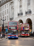 London Buses Passing the Alliance Life Building in Piccadilly Circus Photographic Print by  xPacifica