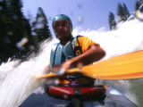 Self Portrait of the Photographer Kayaking Through Rapids Photographic Print by Kate Thompson