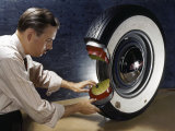 Technician Shows How a Second Inner Tube Reinforces Safety in Tires Photographic Print by Willard Culver