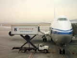Cargo Is Loaded onto a Plane at the Beijing International Airport Photographic Print by  xPacifica
