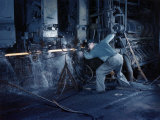 Man Operates a Machine Rolling Flat Sheets of Steel into Pipes Photographic Print by Willard Culver