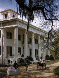 People in Period Costumes Stand Outside Greek Revival Plantation Home Photographic Print by Willard Culver