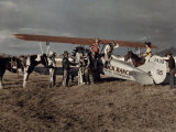 Group of Cowboys Exit a Plane in Phoenix Photographic Print by Clifton R. Adams