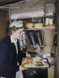 Flight Attendant Sets Up a Passengers Meal on United Airlines Photographic Print by Luis Marden