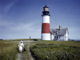 Sailor Walks a Dog Near Sankaty Head Lighthouse Photographic Print by B. Anthony Stewart