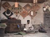 Kite Merchant Sits in His Store in Bombay Lámina fotográfica por Courtellemont, Gervais