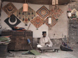 Kite Merchant Sits in His Store in Bombay Photographic Print by Gervais Courtellemont