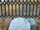 Decorative Wrought Iron Surrounds a Grave in a Cemetary in Nevada Photographic Print by Charles Kogod