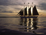 Three Masted Schooner under Sail at Sunset Photographic Print by Michael Melford