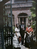 Three Creole Young Adults Stand in a Theater's Courtyard Photographic Print by Edwin L. Wisherd