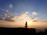 Woman Strikes the Yoga Tree Pose on Top of a Mountain at Sunset Photographic Print by  White & Petteway