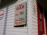 Signs on a Historic Gas Station Offer Gas for 19 Cents a Gallon Photographic Print by  White & Petteway