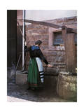 Alsatian Woman Pumps Water from the Town Well Photographic Print by Gervais Courtellemont