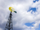 Blades of a Windmill are Painted Yellow to Mimic a Flower Photographic Print by  White & Petteway